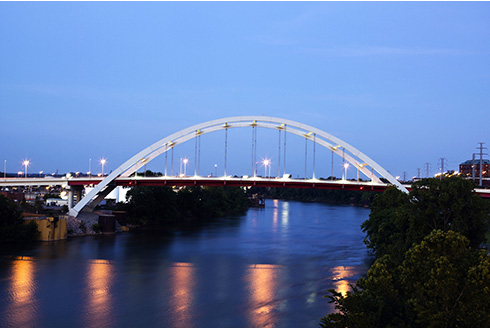 Showing slide 1 of 16 in image gallery, Bridge in downtown Nashville, Tennessee at dusk
