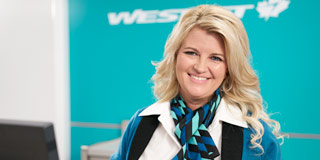 Smiling WestJet owner
