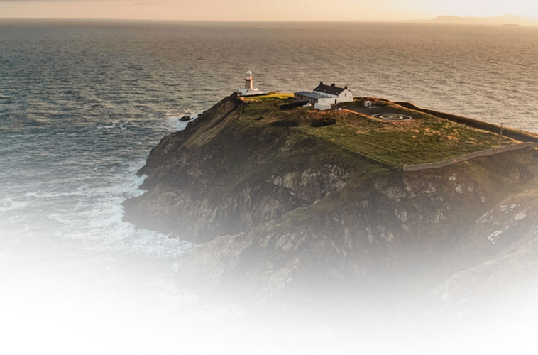 Lighthouse on a peninsula near Dublin, Ireland. Find flights to Dublin with WestJet.