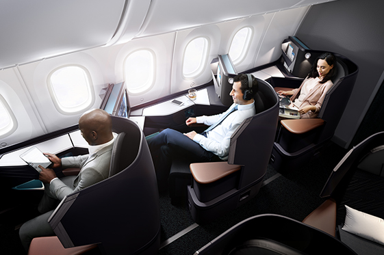 Travellers sitting in 787 Dreamliner Business Class lay-flat seats.