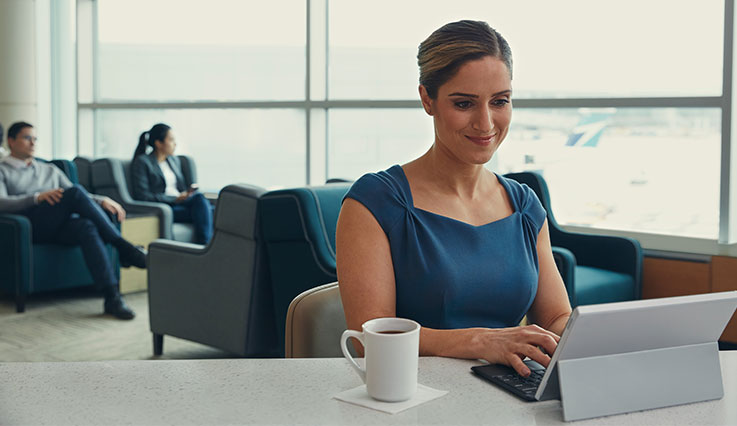 Female business traveller working at airport lounge
