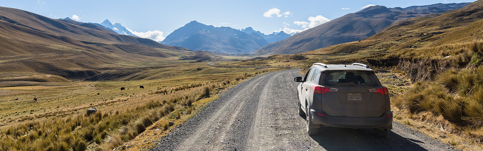 car on gravel mountain road