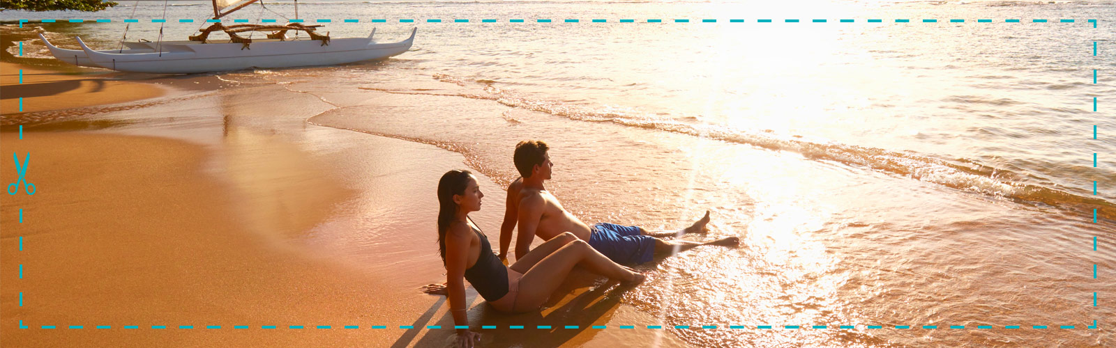 Couple lying on the beach with a dotted cutout line around the image.
