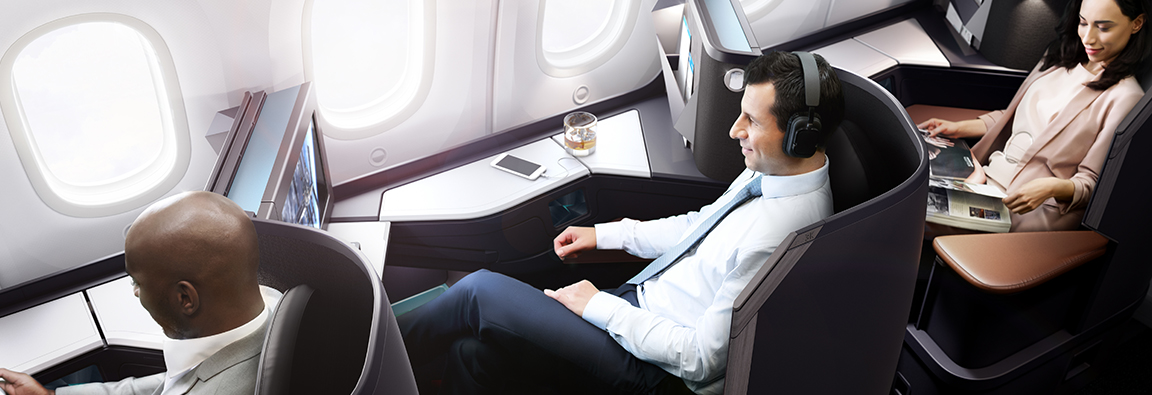 Gentleman enjoying inflight entertainment in a Business cabin pod onboard the WestJet 787 Dreamliner