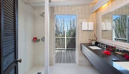 Showing slide 1 of 4 in image gallery, Deluxe pool cottage bathroom