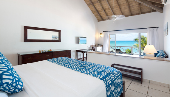 Showing slide 1 of 4 in image gallery showcasing Premium Beachfront Suite