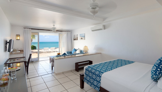 Showing slide 2 of 4 in image gallery showcasing Premium Beachfront Suite