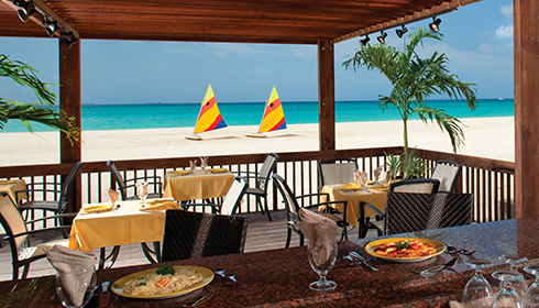 Showing slide 15 of 19 in image gallery, Divi Aruba All Inclusive - services - Oceanfront Sandpiper Bar
