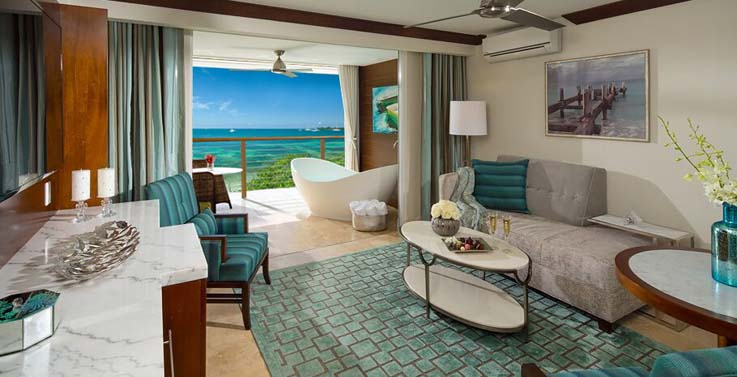 Showing slide 2 of 3 in image gallery showcasing Royal seaside crystal lagoon one bedroom oceanveiw butler suite w/balcony tranquility soaking tub (OL1B)