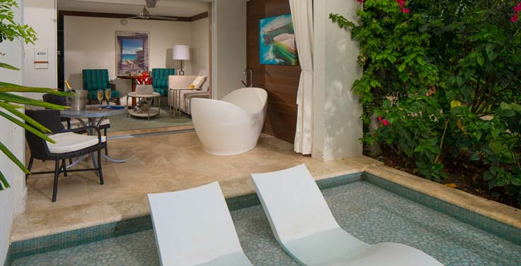 Showing slide 2 of 2 in image gallery showcasing Royal seaside crystal lagoon swim up one bedroom butler suite w/patio tranquility soaking tub (1SUP)