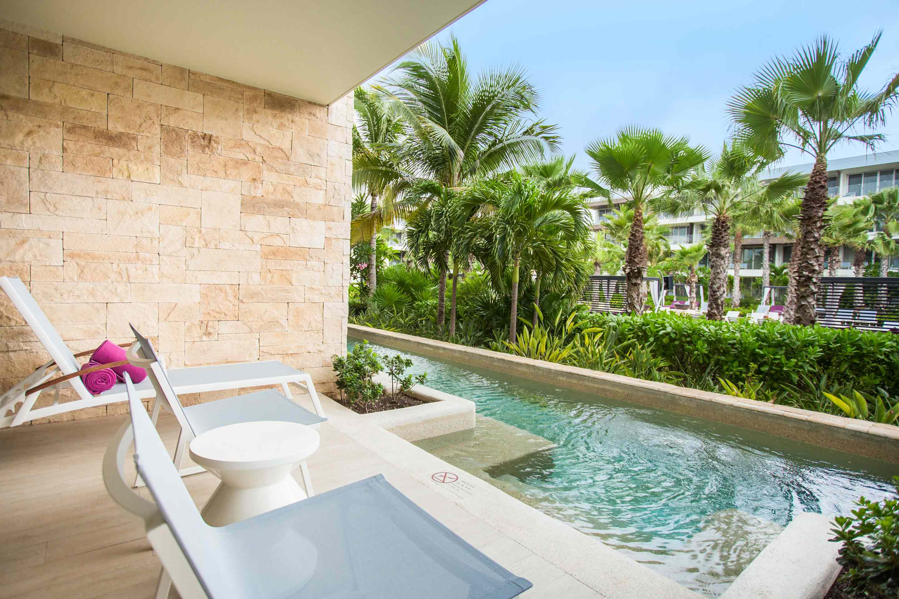 Showing slide 3 of 3 in image gallery showcasing Allure Junior Suite Swim out Tropical View