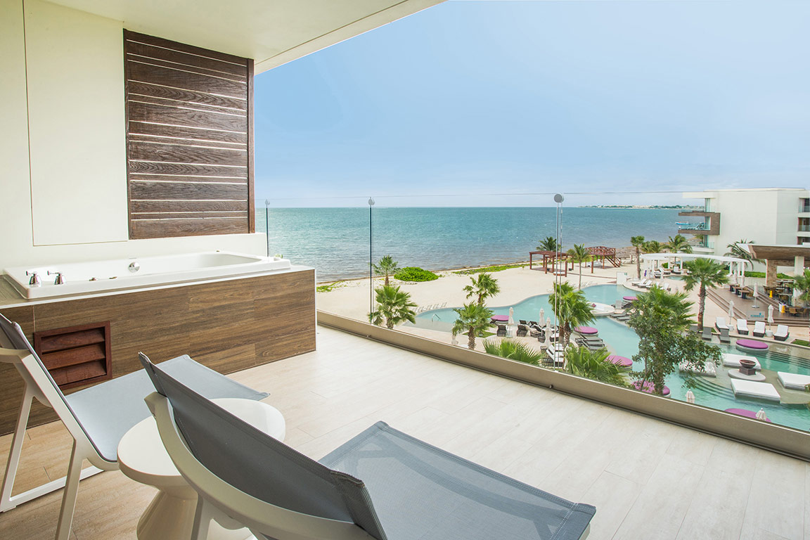 Showing slide 4 of 4 in image gallery showcasing Xhale Club Junior Suite Ocean View