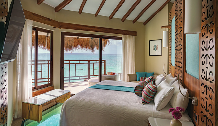 Showing slide 1 of 4 in image gallery showcasing Palafitos Overwater Bungalow