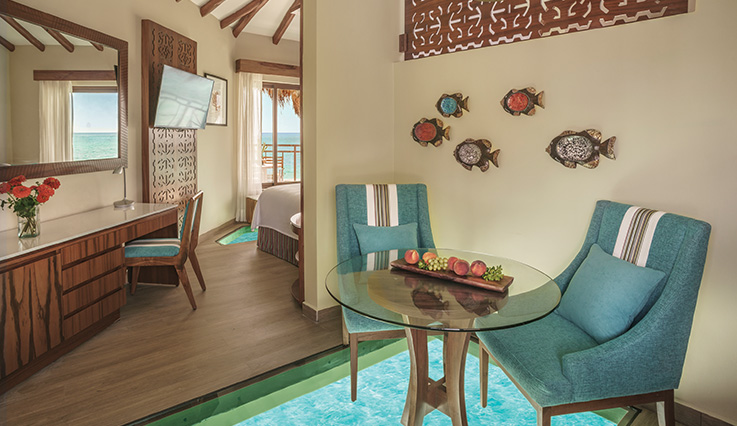 Showing slide 2 of 4 in image gallery showcasing Palafitos Overwater Bungalow