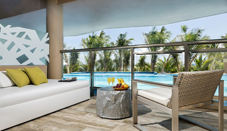 Showing slide 2 of 4 in image gallery showcasing Oceanfront Pool Swim Up Suite