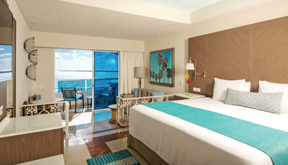 Showing slide 1 of 4 in image gallery showcasing Junior Suite Oceanfront