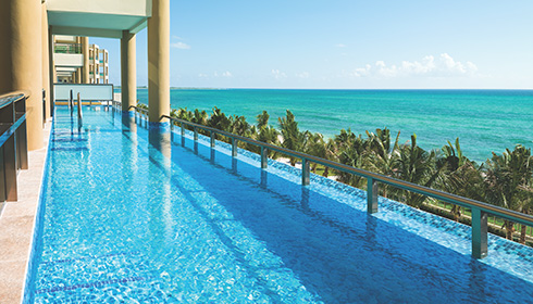 Showing slide 4 of 4 in image gallery, Oceanfront 1 Bedroom Swim Up Suite
