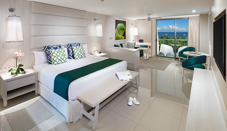 Showing slide 1 of 3 in image gallery showcasing Deluxe Junior Suite Ocean View