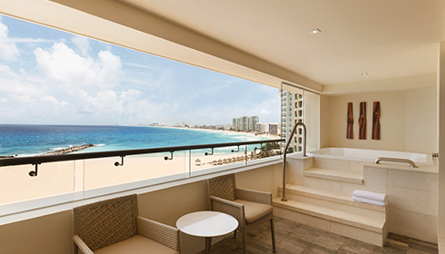 Showing slide 2 of 2 in image gallery showcasing Club Ocean Front Corner Suite