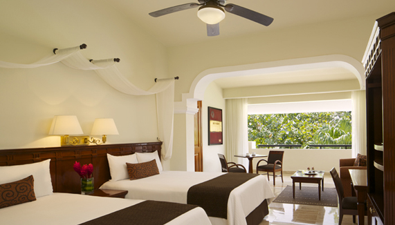Showing slide 2 of 2 in image gallery showcasing Deluxe Junior Suite Tropical View