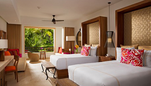 Showing slide 2 of 2 in image gallery, Junior Suite Tropical View Doubles