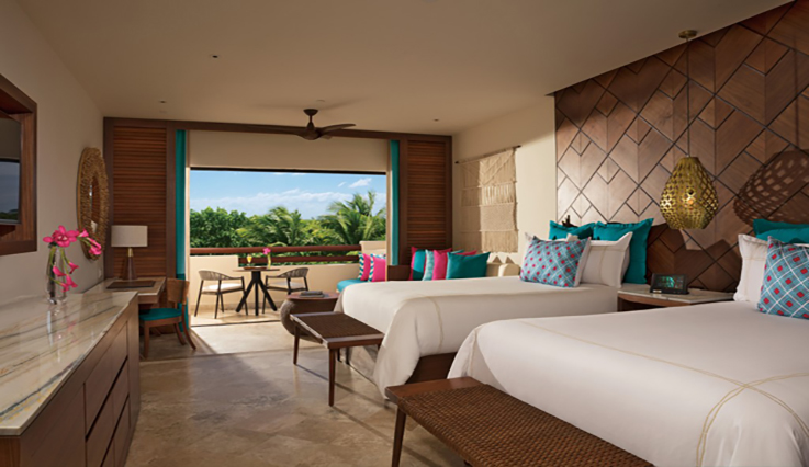 Showing slide 2 of 3 in image gallery showcasing Junior Suite Tropical View