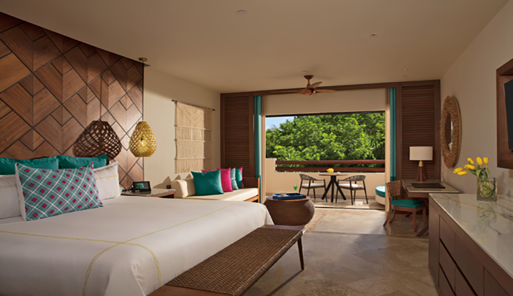 Showing slide 1 of 3 in image gallery showcasing Junior Suite Tropical View