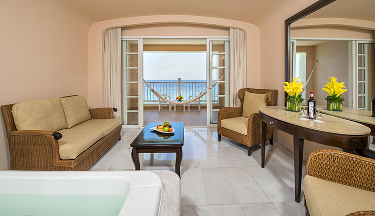 Showing slide 1 of 3 in image gallery showcasing Oceanfront Suite