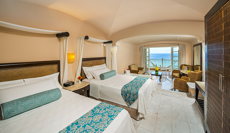Showing slide 2 of 3 in image gallery showcasing Oceanfront Suite