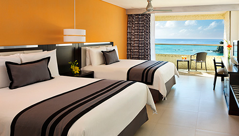 Showing slide 5 of 23 in image gallery, Preferred club deluxe ocean front room - Two double beds