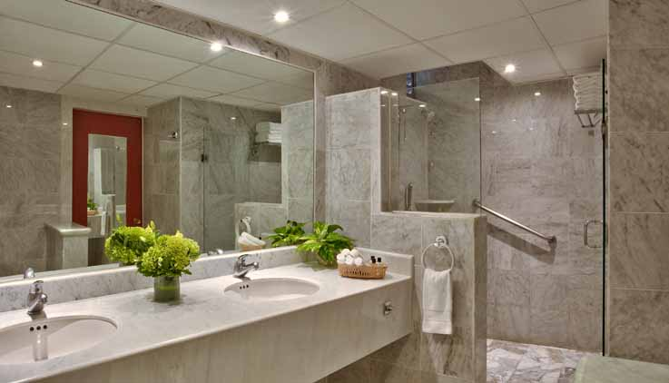 Showing slide 1 of 2 in image gallery, Brisas Beach Club Suite bathroom