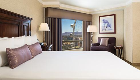 Showing slide 1 of 2 in image gallery, Mardi Gras Room with king bed and high roller view