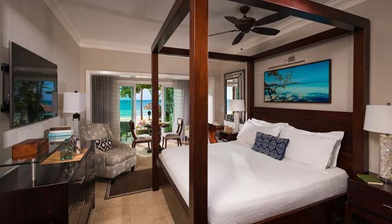 Image showcasing Paradise Honeymoon Beachfront Walkout Club Level Room (WB)