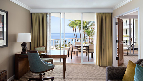 Showing slide 2 of 2 in image gallery, Deluxe ocean view suite living room