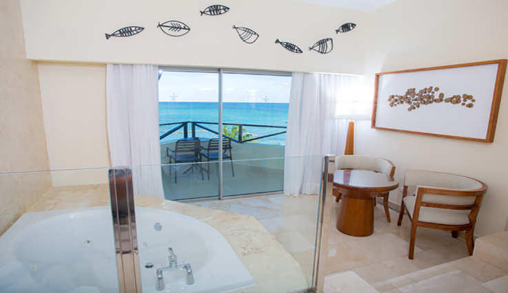 Showing slide 2 of 4 in image gallery showcasing Junior Suite Premium Ocean Front Jacuzzi