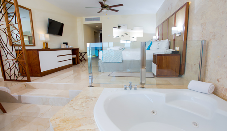 Showing slide 3 of 4 in image gallery showcasing Junior Suite Premium Ocean Front Jacuzzi