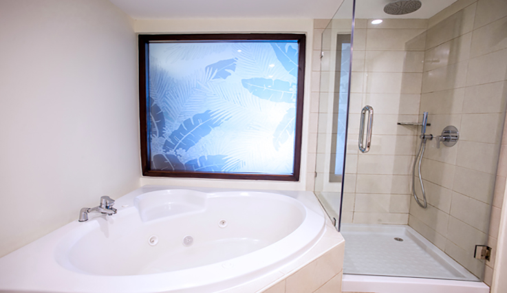 Showing slide 3 of 3 in image gallery showcasing Junior Suite Premium Tropical View Jacuzzi