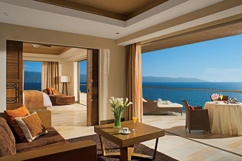 Showing slide 2 of 4 in image gallery showcasing Preferred Club Master Suite Oceanfront