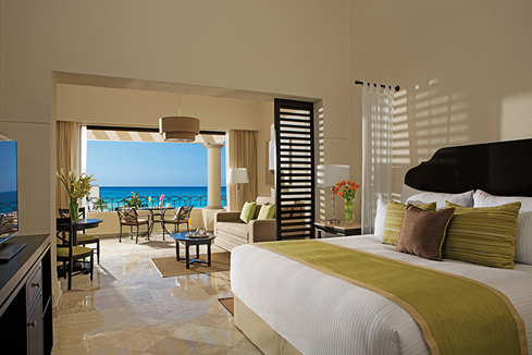 Showing slide 1 of 4 in image gallery showcasing Junior Suite Ocean View