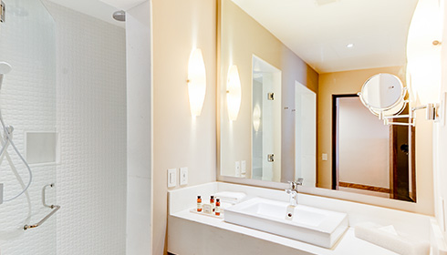 Showing slide 2 of 2 in image gallery, Towers Deluxe Ocean View Room Bathroom
