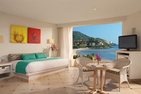Showing slide 1 of 2 in image gallery showcasing Sun Club Family Ocean Front Suite