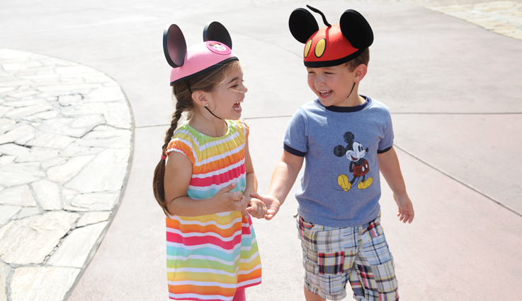 Children wearing mouse ears