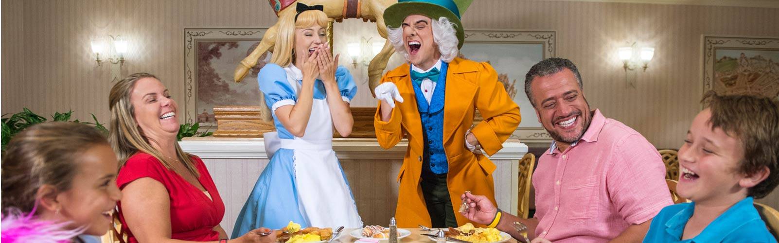 Alice and Mad hatter at family breakfast