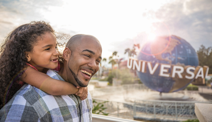 father and daughter in front of Universal Orlando Resort™
