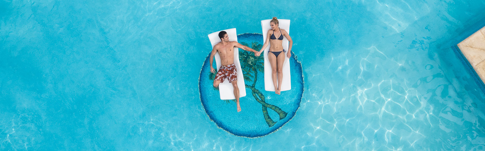 couple floating in pool
