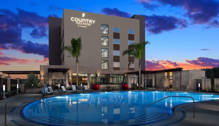 exterior of Country Inn & Suites by Radisson at night