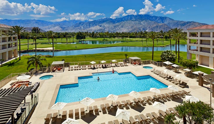 view of pool and mountain range in the distance