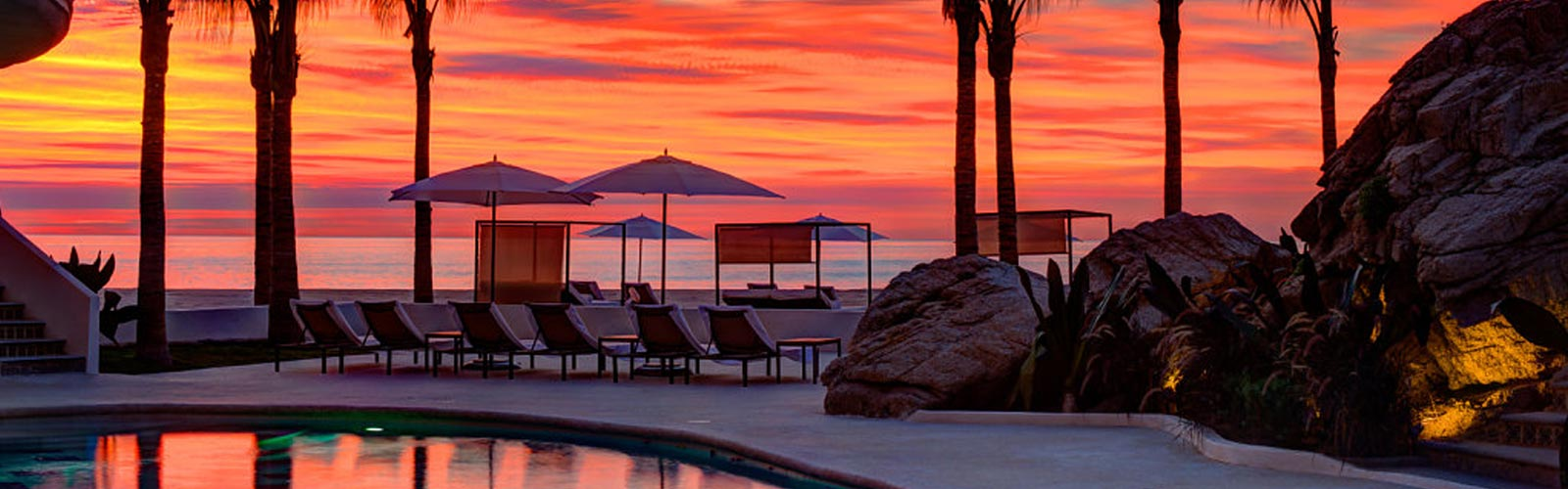 lounge chairs and pool at sunset
