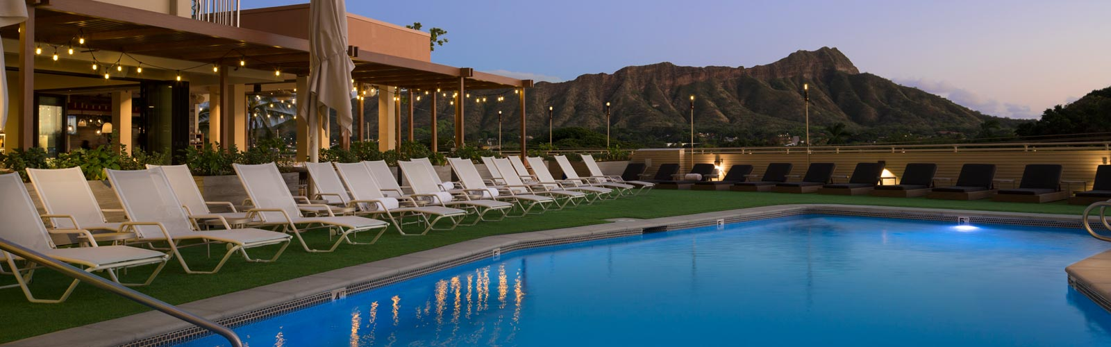 pool at dusk with mountains in background