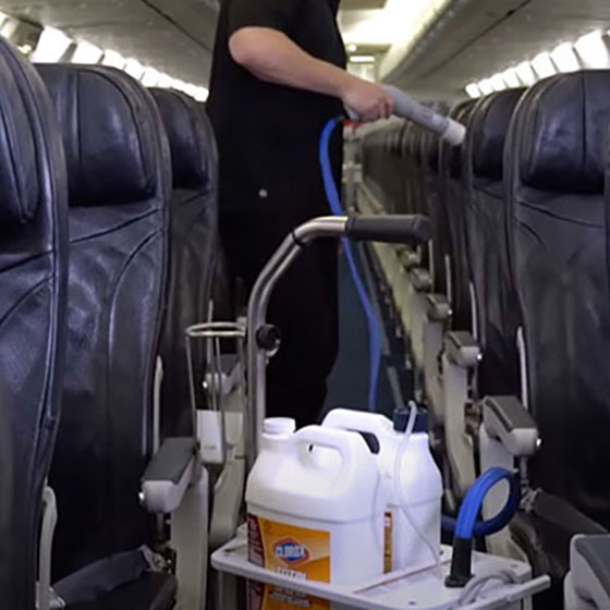 Cabin crew cleaning seats